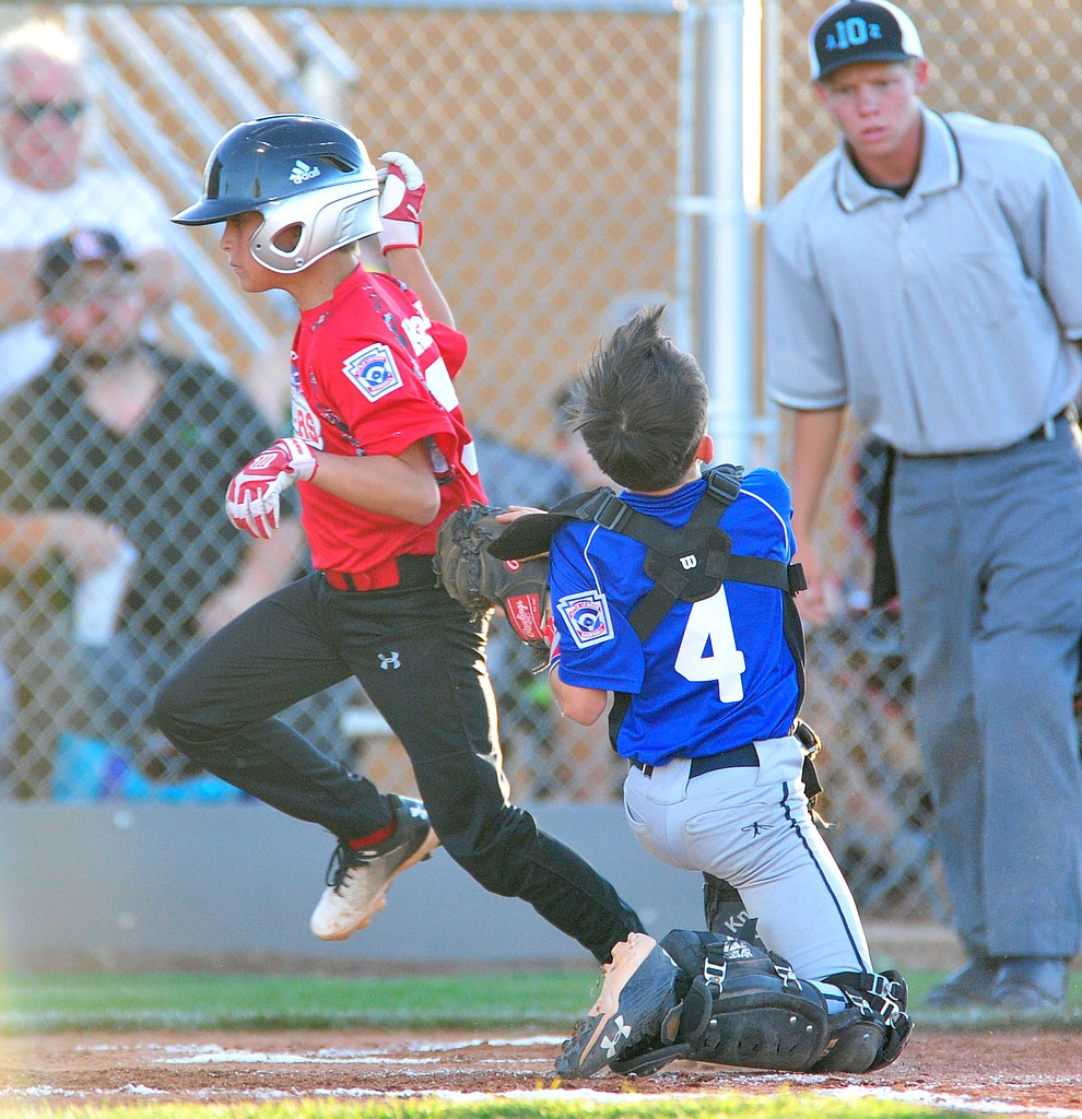 Prescott's Jacob Patterson tags out Taylor Keppel as they took on the Prescott Valley team in the Little League D10 Under 11 Championship game at Ziegler Field in Prescott Tuesday, June 26, 2018. (Les Stukenberg/Courier)