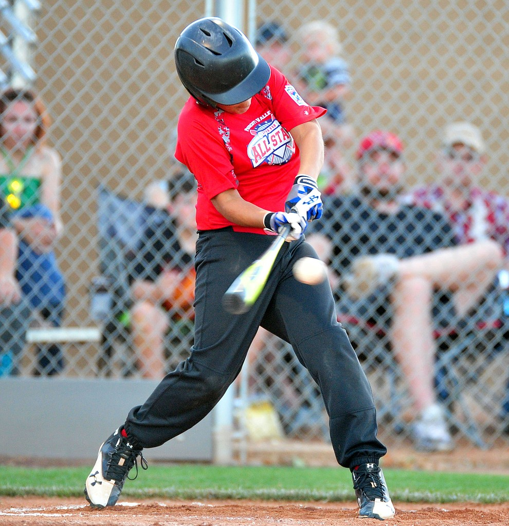 Prescott Vallley's Mikey Jones makes contact as they took on the Prescott team in the Little League D10 Under 11 Championship game at Ziegler Field in Prescott Tuesday, June 26, 2018. (Les Stukenberg/Courier)