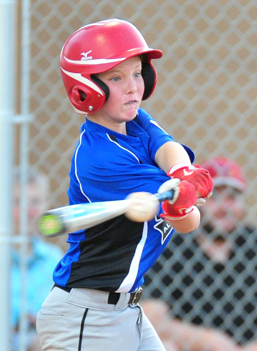 Prescott's Adrian Sanderford singles as they took on the Prescott Valley team in the Little League D10 Under 11 Championship game at Ziegler Field in Prescott Tuesday, June 26, 2018. (Les Stukenberg/Courier)