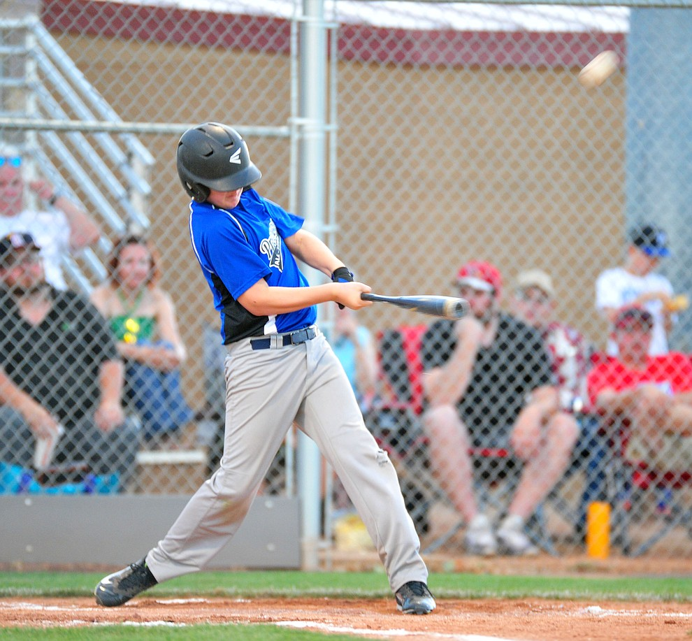 Prescott's Zane Gaul lanuches a long double as they took on the Prescott Valley team in the Little League D10 Under 11 Championship game at Ziegler Field in Prescott Tuesday, June 26, 2018. (Les Stukenberg/Courier)