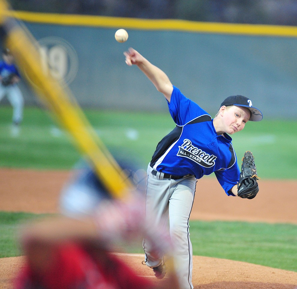 Prescott's Adrian Sanderford delivers a pitch as they took on the Prescott Valley team in the Little League D10 Under 11 Championship game at Ziegler Field in Prescott Tuesday, June 26, 2018. (Les Stukenberg/Courier)