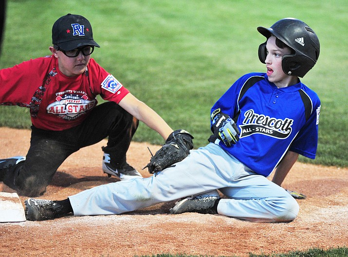 Prescott Valley's Brayden Munday, left, tags out Prescott's Coley Fundalewicz at home plate as the two teams locked horns for the District 10 11U championship Tuesday, June 26, 2018, at Ziegler Field in Prescott. (Les Stukenberg/Courier)