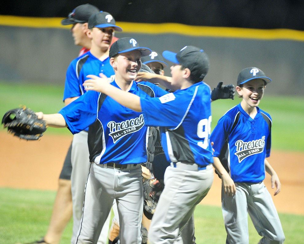 Prescott players celebrate after they defeated the Prescott Valley team 13-0 in the Little League D10 Under 11 Championship game at Ziegler Field in Prescott Tuesday, June 26, 2018. (Les Stukenberg/Courier)