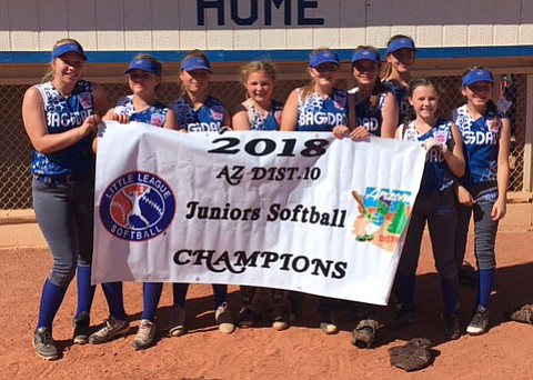 The Bagdad Juniors All-Stars softball team pose for a photo after claiming the District 10 championship June 24 in Bagdad. (Bagdad LL/Courtesy)
