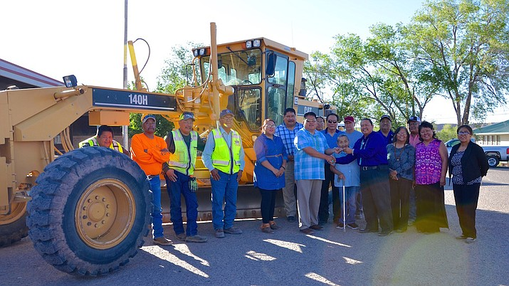 Council Delegate  Alton Joe Shepherd presents a Caterpillar    grader key to Ganado Chapter officials and community members at Ganado Chapter in Ganado, Arizona June12.   (Navajo Nation Office of the Speaker)