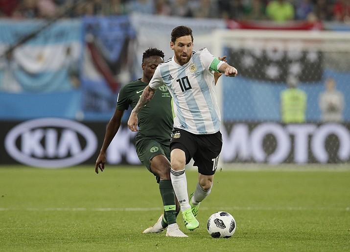 Argentina's Lionel Messi, front competes for the ball during the group D match between Argentina and Nigeria at the 2018 soccer World Cup in the St. Petersburg Stadium in St. Petersburg, Russia, Tuesday, June 26, 2018. (Dmitri Lovetsky/AP)