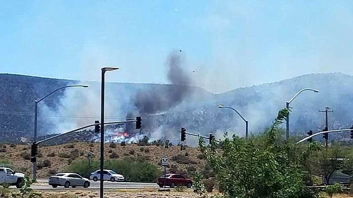 Local fire agencies work to extinguish a brush fire just south of Camp Verde that forced the closure of I-17 between SR 260 and SR 169. All lanes of I-17 are now open. (Photo courtesy of Brian Thompson)