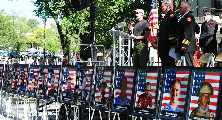 Prescott firefighter Pat McCarty reads names of the fallen at a June 30, 2015, memorial service for the Granite Mountain Hotshots at Yavapai County courthouse plaza. Memorial events are planned June 30, 2018, to commemorate the five-year anniversary of their deaths. (Les Stukenberg/Courier)