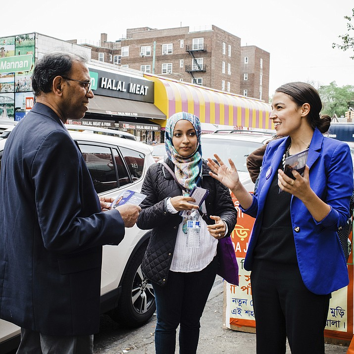 This May 6, 2018 photo provided by the Alexandria Ocasio-Cortez Campaign shows candidate Alexandria Ocasio-Cortez, right, during a Bengali community outreach in New York. Ocasio-Cortez, a 28-year-old political novice running on a low budget and an unabashedly liberal platform, upset longtime U.S. Rep. Joseph Crowley on Tuesday in the Democratic congressional primary in New York. (Corey Torpie/Courtesy Alexandria Ocasio-Cortez Campaign)