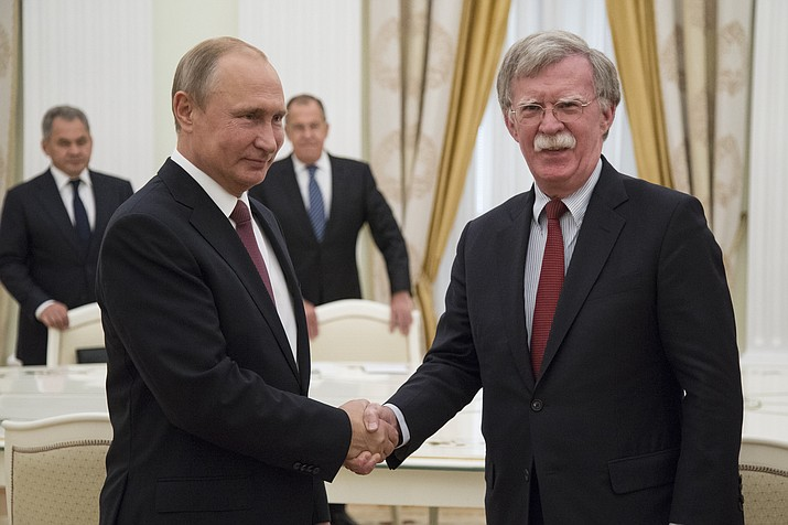 Russian President Vladimir Putin, left, shakes hands with U.S. National security adviser John Bolton during their meeting in the Kremlin in Moscow, Russia, Wednesday, June 27, 2018.  U.S. President Donald Trump's national security adviser is due in Moscow Wednesday to lay the groundwork for a possible U.S.-Russia summit. (Alexander Zemlianichenko/AP Photo, Pool)