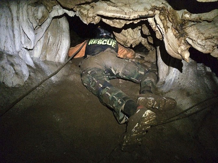 In this photo released by the Thailand Department of National Parks and Wildlife, Wednesday, June 27, 2018, rescue personnel search for alternate entrances to a cave where 12 boys of a soccer team and their coach went missing in Mae Sai, Chiang Rai, northern Thailand. Rain is continuing to fall and water levels keep rising inside a cave in northern Thailand, frustrating the search for the boys and their coach who have been missing since Saturday. (Thailand Department of National Parks and Wildlife)