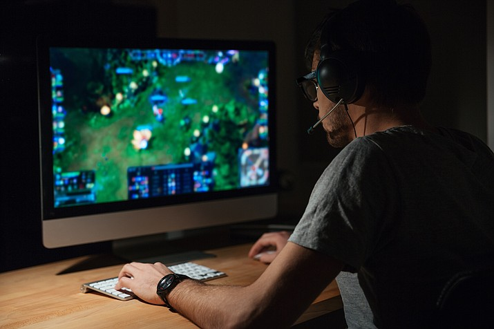 "The World Health Organization's description of ""gaming disorder"" is vague and doesn't really offer a description of how much digital gaming is too much. (Adobe Images)"