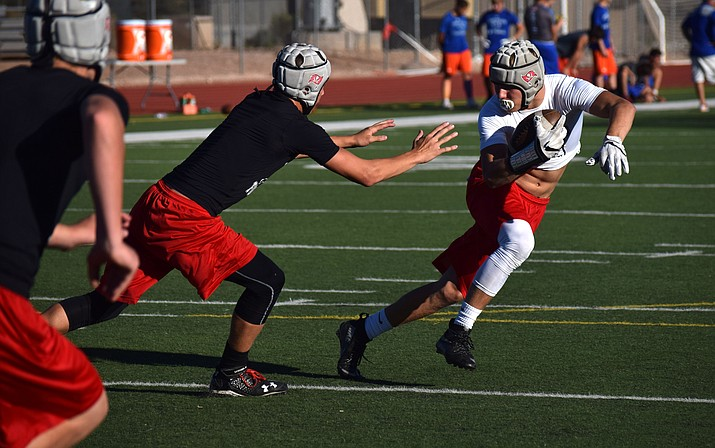 Mingus senior Alex Nelson tries to evade defenders during a 7-on-7 game at home on Wednesday afternoon. VVN/James Kelley