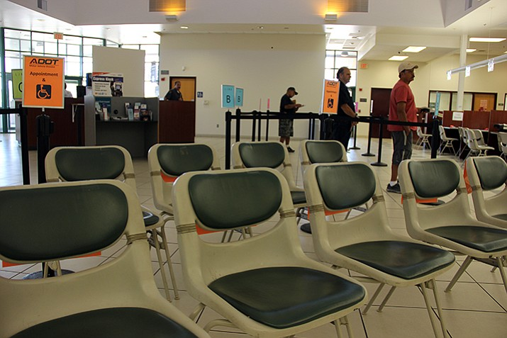 A select number of seats remain at the Arizona Department of Transportation Motor Vehicle Division in Prescott. These seats are reserved for those with an appointment or who request to sit instead of stand in their designated line. (Max Efrien/Courier, file)