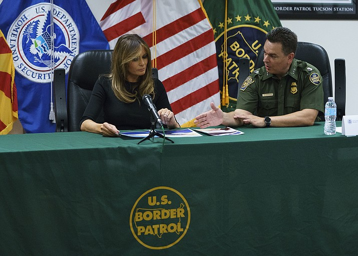 Rodolfo Karisch, Chief Patrol Agent TCA Border Patrol, right, talks with first lady Melania Trump during a roundtable discussion as she visits a U.S. Customs and border and protection facility in Tucson, Thursday, June 28, 2018. (AP Photo/Carolyn Kaster)