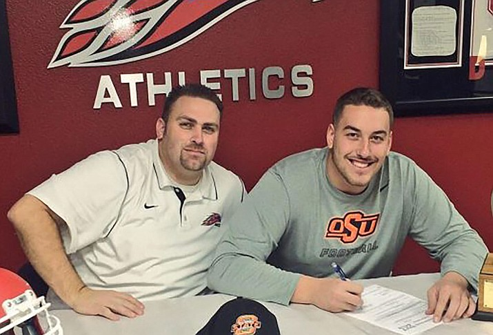 Former Mesa Community College offensive lineman Brandon Pertile, right, signed with Oklahoma State, thanks to the assistance of MCC coach Ryan Felker. (Photo courtesy of Brandon Pertile/Cronkite News)