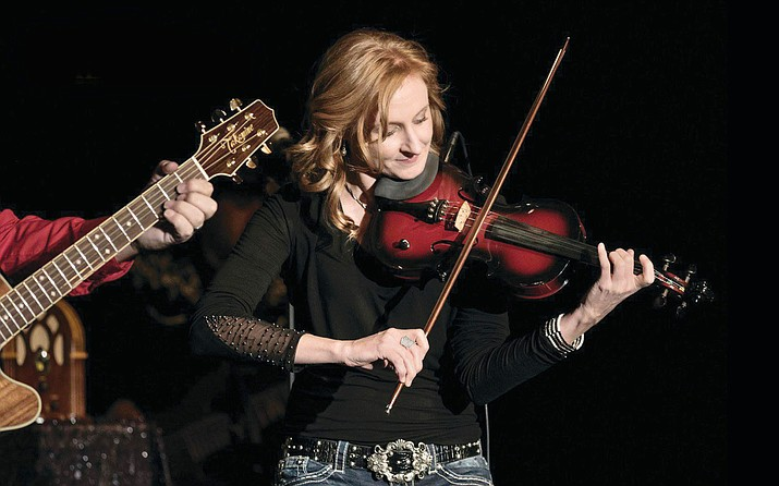 Heide Hille is the fiddler and one of seven performers for Nashville Gold, which performs at the Elks Theatre and Performing Arts Center Friday, June 29. (Autumn/Lynn Tummavichaku/Courtesy)
