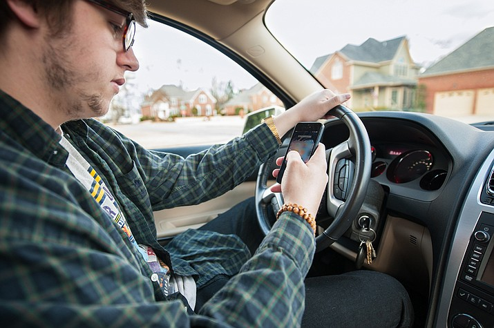 Starting on July 1, 2018, Arizona law will place some restrictions on the ability of motorists to use their cell phones while driving, but the law applies only to teens with a learner's permit or those who are within the first six months of being able to drive. (File photo)