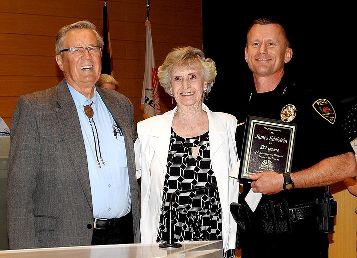 James Edelstein, deputy chief of Prescott Valley Police Department, right, is honored at the Prescott Valley Town Council meeting June 14 for his 20 years of service; shown here with Mayor Harvey Skoog, left, and Vice Mayor Lora Lee Nye. (Town of Prescott Valley/Courtesy)