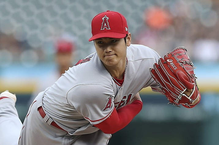 In this Wednesday, May 30, 2018 file photo,Los Angeles Angels starting pitcher Shohei Ohtani throws during the second inning of a baseball game against the Detroit Tigers in Detroit. Shohei Ohtani's elbow injury has healed enough that the Los Angeles Angels' two-way star can begin a hitting program. General manager Billy Eppler said Thursday, June 28, 2018 that Ohtani underwent an MRI in Los Angeles that showed improvement to his ligament, clearing him to take batting practice in private. (Carlos Osorio/AP, File)