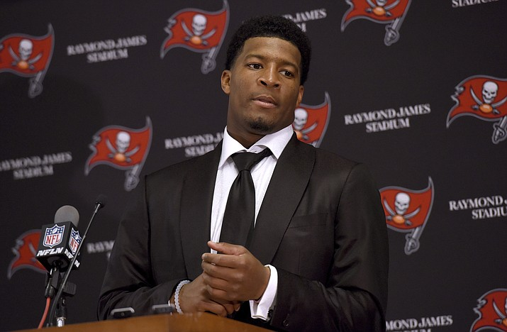 In this Nov. 27, 2016, file photo, Tampa Bay Buccaneers quarterback Jameis Winston (3) speaks to the media following a win over the Seattle Seahawks in an NFL football game, in Tampa, Fla. (Jason Behnken/AP, File)