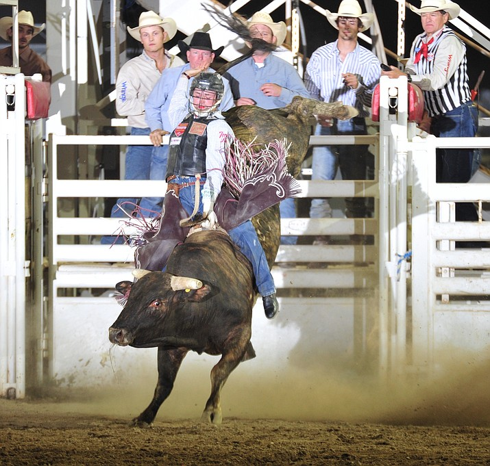 Ty Wallace from Collbran, Colorado, rides Cowboyd for a score of 86 Thursday, June 28, 2018, at the opening performance of the Prescott Frontier Days Rodeo in Prescott. (Les Stukenberg/Courier)