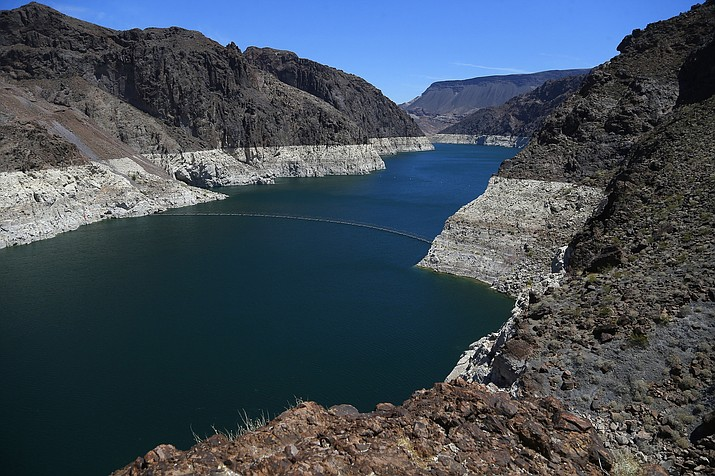The low level of the water line is shown on the banks of the Colorado River, Thursday, May 31, 2018, in Hoover Dam, Ariz. Arizona is renewing a focus on a drought contingency plan for the shrinking supply of Colorado River water, and other Western states are paying close attention. (AP Photo/Ross D. Franklin)