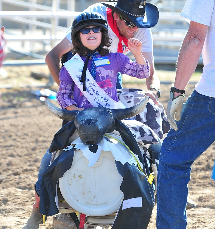 Eliza Kelly shows good bull-riding form during the Happy Hearts Rodeo for Exceptional Children before the opening performance of the Prescott Frontier Days Rodeo Thursday, June 28, 2018. (Les Stukenberg/Courier)