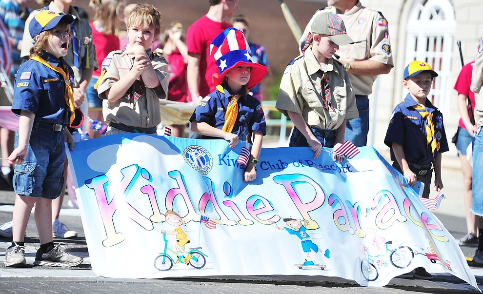 Cub Scouts prepare to lead the 77th annual Kiwanis Kiddie Parade in downtown Prescott Friday, June 29, 2018.(Les Stukenberg/Courier)