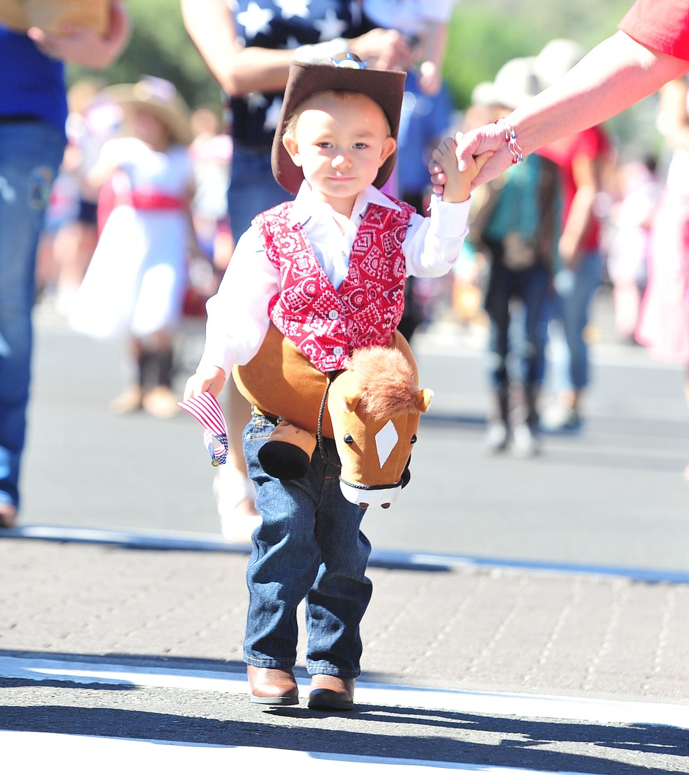 Cowboys ride in the 77th annual Kiwanis Kiddie Parade in downtown Prescott Friday, June 29, 2018.(Les Stukenberg/Courier)