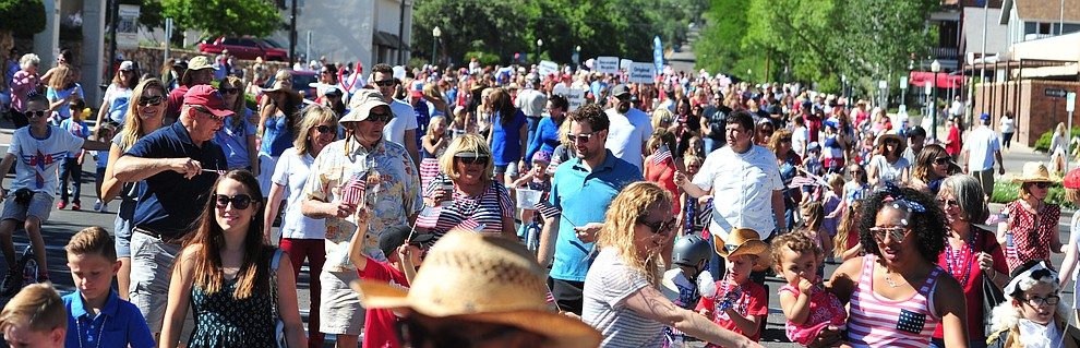 Hundreds march in the 77th annual Kiwanis Kiddie Parade in downtown Prescott Friday, June 29, 2018.(Les Stukenberg/Courier)