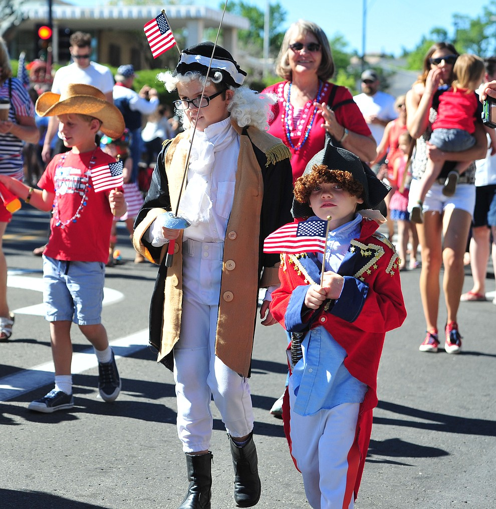 Historical characters march during the 77th annual Kiwanis Kiddie Parade in downtown Prescott Friday, June 29, 2018.(Les Stukenberg/Courier)