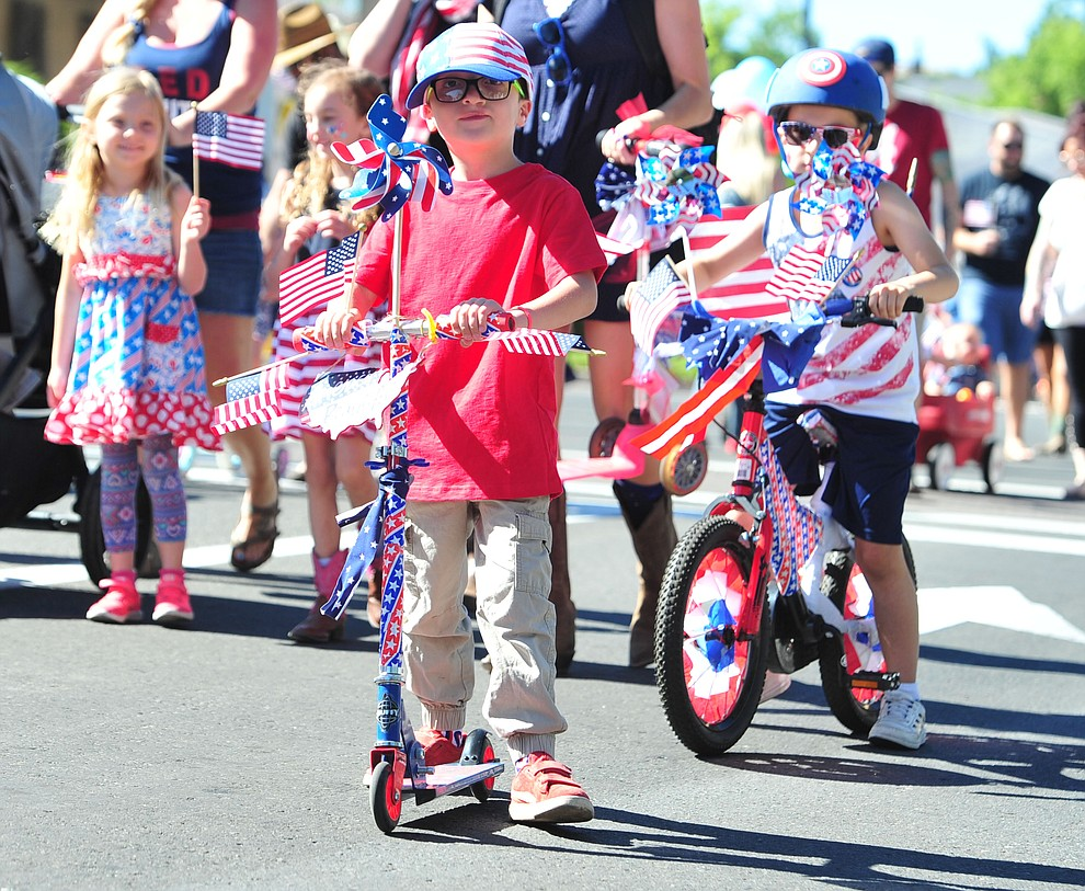 Decorated scooters and bikes are the rage during the 77th annual Kiwanis Kiddie Parade in downtown Prescott Friday, June 29, 2018.(Les Stukenberg/Courier)