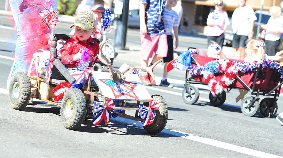 Some children get to ride during the 77th annual Kiwanis Kiddie Parade in downtown Prescott Friday, June 29, 2018.(Les Stukenberg/Courier)