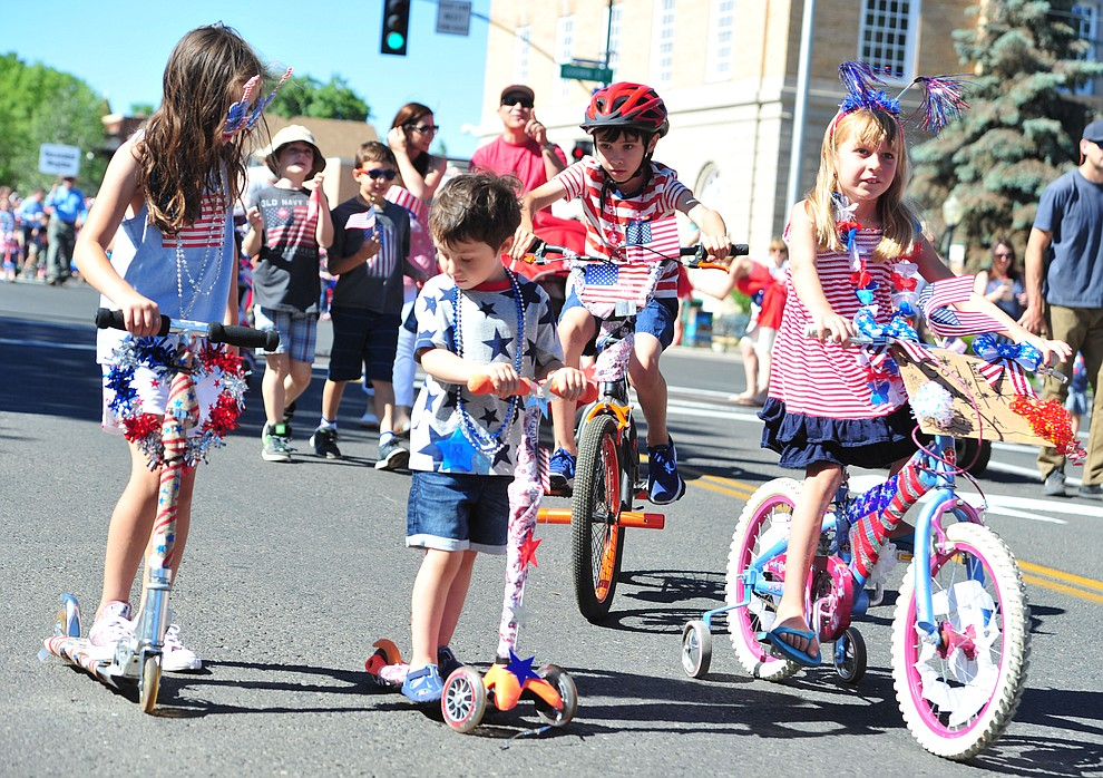Patriotic scooters and bikes during the 77th annual Kiwanis Kiddie Parade in downtown Prescott Friday, June 29, 2018.(Les Stukenberg/Courier)