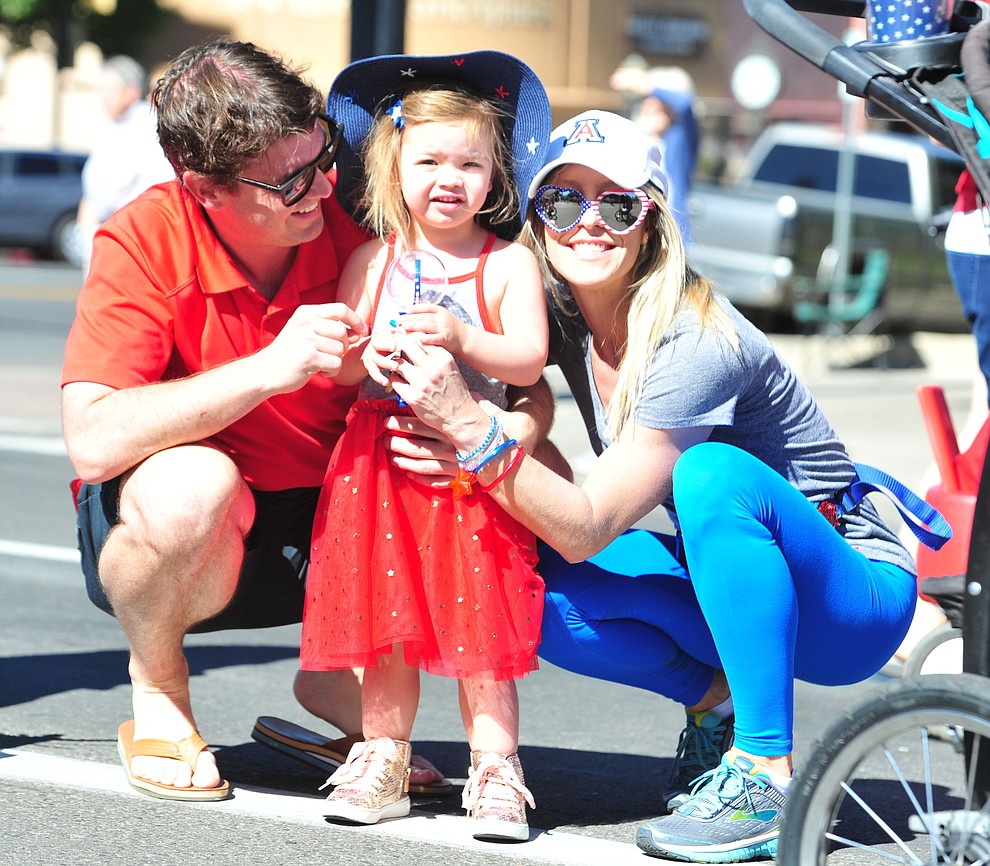 Family's are all smiles during the 77th annual Kiwanis Kiddie Parade in downtown Prescott Friday, June 29, 2018.(Les Stukenberg/Courier)