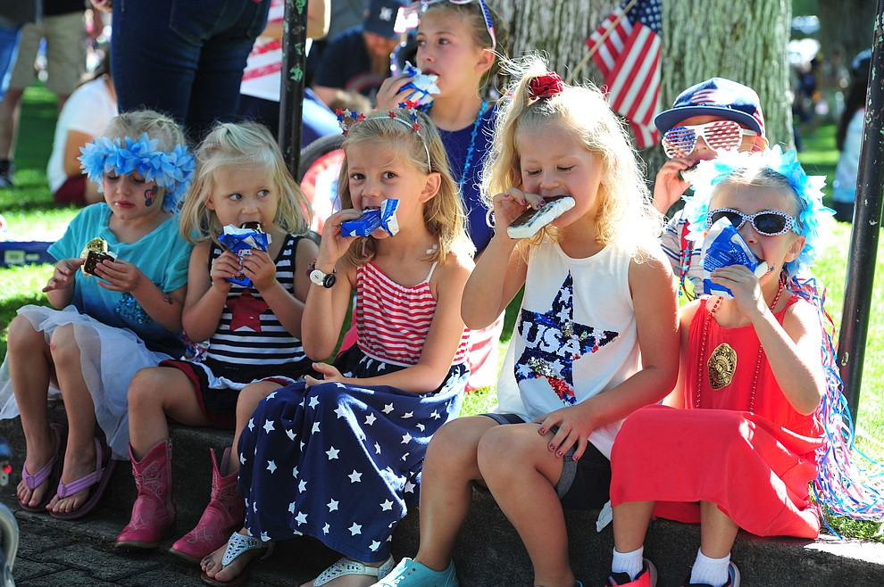 What's better than a morning ice cream sandwich with friends following the 77th annual Kiwanis Kiddie Parade in downtown Prescott Friday, June 29, 2018.(Les Stukenberg/Courier)