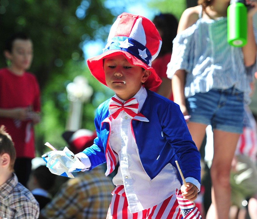 Even Uncle Sam enjoys an ice cream sandwich following the 77th annual Kiwanis Kiddie Parade in downtown Prescott Friday, June 29, 2018.(Les Stukenberg/Courier)
