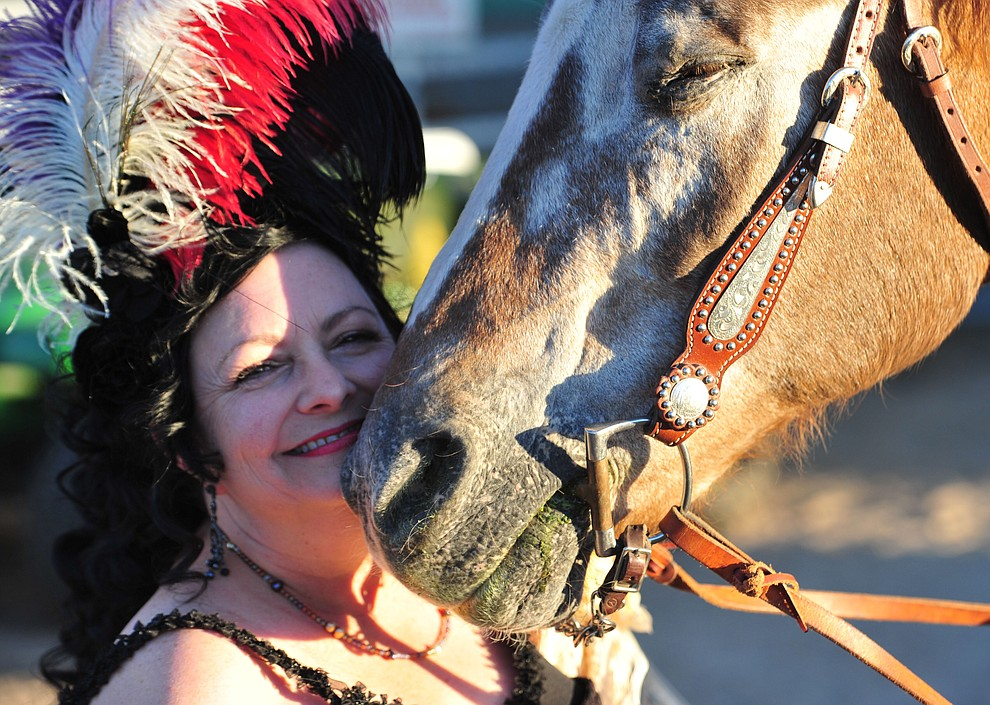 Charmaigne Tickle hangs out with MoSugar before the opening performance of the Prescott Frontier Days Rodeo Thursday, June 28, 2018. (Les Stukenberg/Courier)