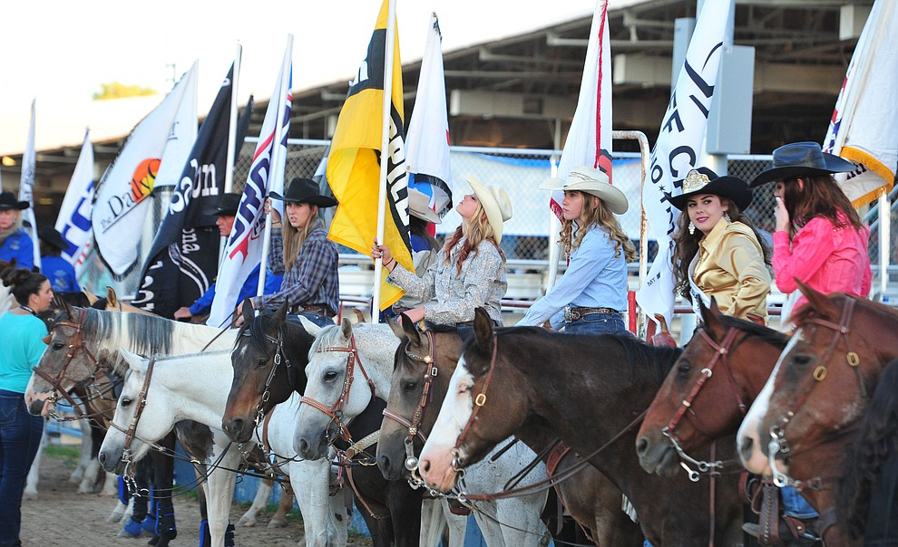 Grand entry participants wait for the opening performance of the Prescott Frontier Days Rodeo Thursday, June 28, 2018. (Les Stukenberg/Courier)