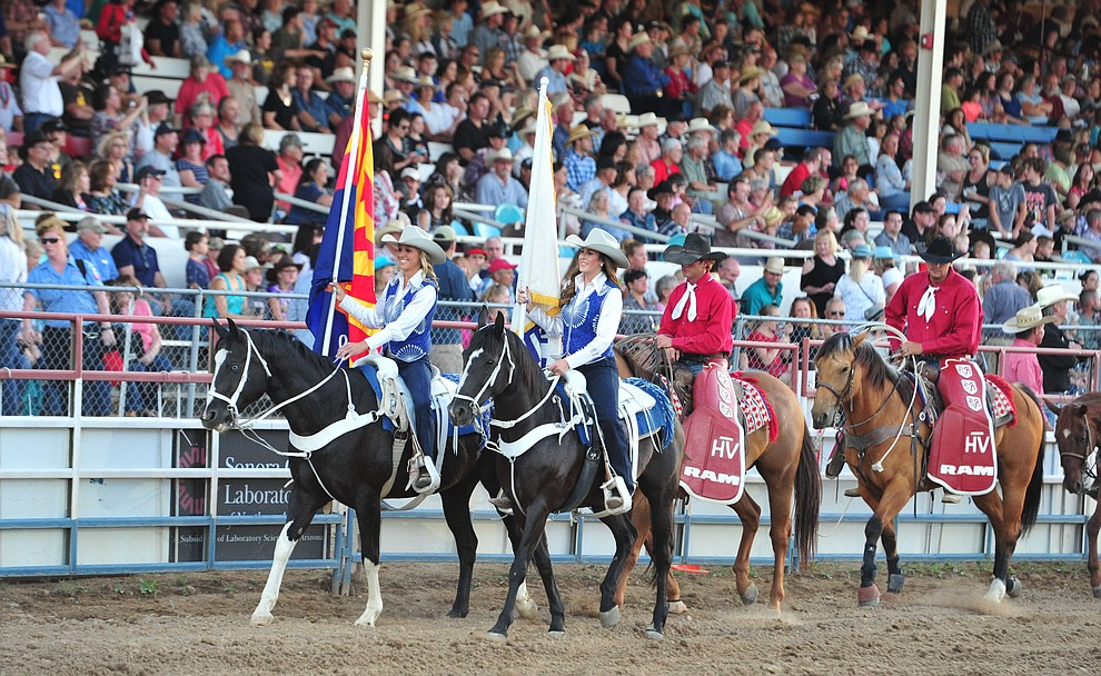 The Grand Entry begins during the opening performance of the Prescott Frontier Days Rodeo Thursday, June 28, 2018. (Les Stukenberg/Courier)