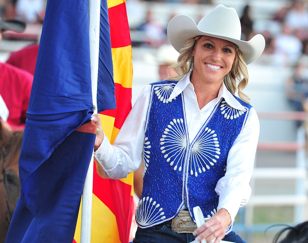 Kimberly Harmon brings in the Arizona flag during the opening performance of the Prescott Frontier Days Rodeo Thursday, June 28, 2018. (Les Stukenberg/Courier)