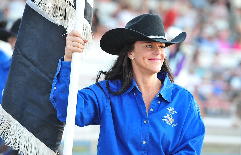 Morgan Peterson rides in the grand entry during the opening performance of the Prescott Frontier Days Rodeo Thursday, June 28, 2018. (Les Stukenberg/Courier)
