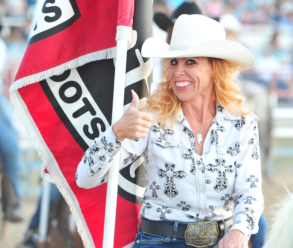 It's thumbs up in the grand entry during the opening performance of the Prescott Frontier Days Rodeo Thursday, June 28, 2018. (Les Stukenberg/Courier)