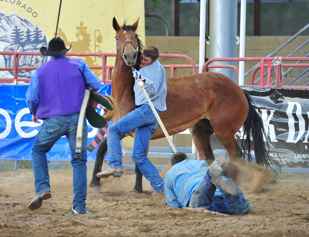 Wild horse racing action during the opening performance of the Prescott Frontier Days Rodeo Thursday, June 28, 2018. (Les Stukenberg/Courier)
