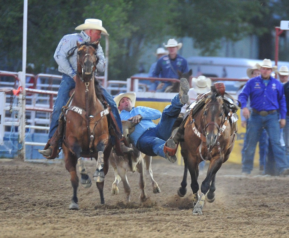 Errol Frain had a 6.6 second run in the steer wrestling during the opening performance of the Prescott Frontier Days Rodeo Thursday, June 28, 2018. (Les Stukenberg/Courier)