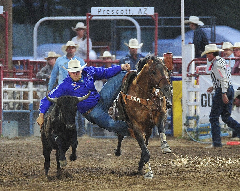 Will Lummus had a 15.6 second run in the steer wrestling during the opening performance of the Prescott Frontier Days Rodeo Thursday, June 28, 2018. (Les Stukenberg/Courier)