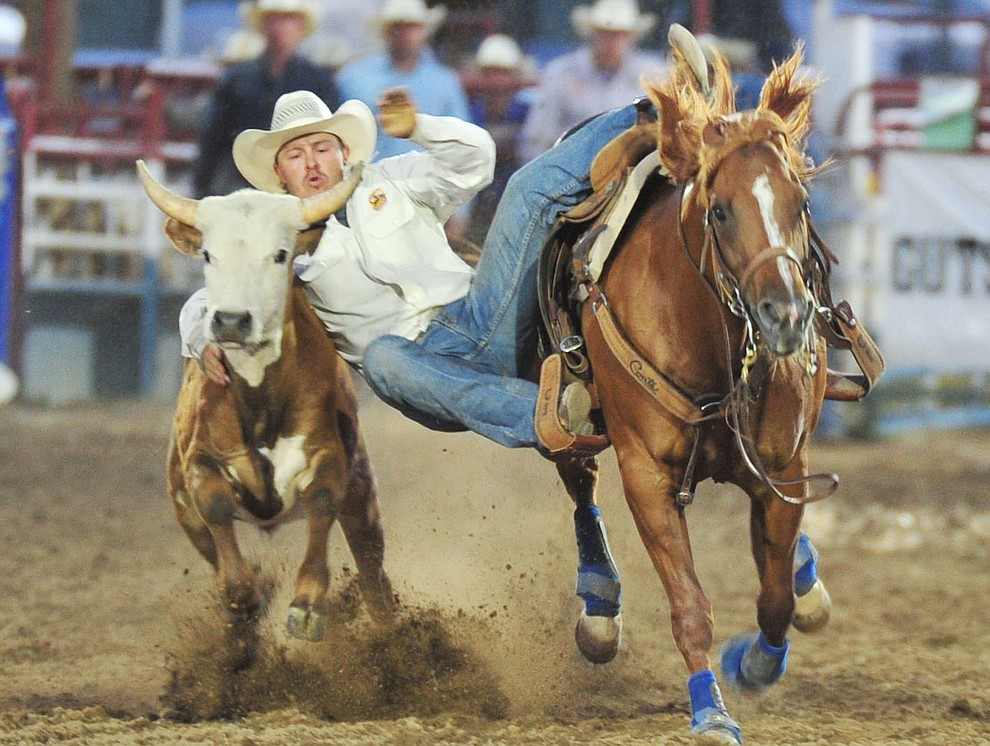 Cody Harmon had a 7.1 second run in the steer wrestling during the opening performance of the Prescott Frontier Days Rodeo Thursday, June 28, 2018. (Les Stukenberg/Courier)