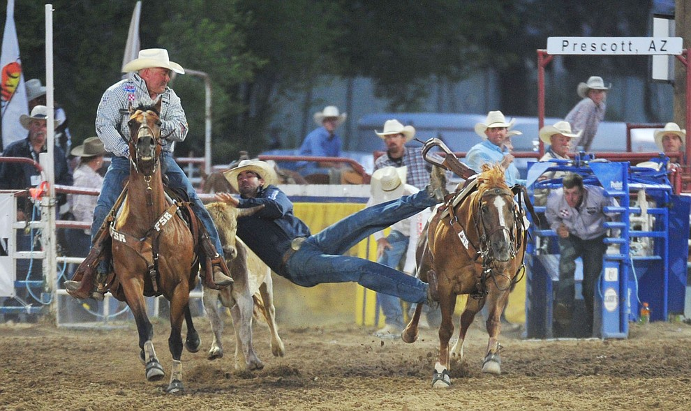 Cody Cabral had a fast 3.9 second run in the steer wrestling during the opening performance of the Prescott Frontier Days Rodeo Thursday, June 28, 2018. (Les Stukenberg/Courier)