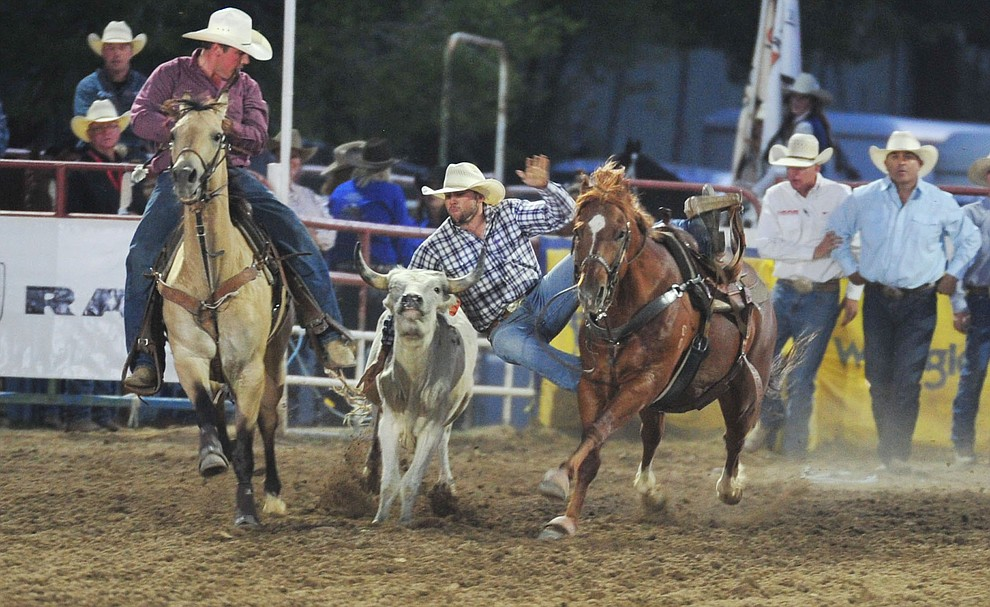 McLane Cole Arballo had a 14.3 second run in the steer wrestling during the opening performance of the Prescott Frontier Days Rodeo Thursday, June 28, 2018. (Les Stukenberg/Courier)
